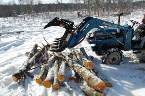 piling logs with tractor grapple